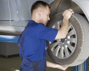 man checking the condition of the control arms